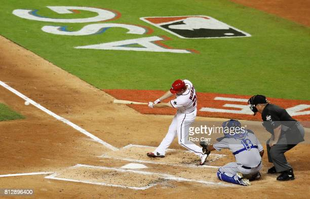Daniel Murphy of the Washington Nationals and the National League hits a single in the second inning against the American League during the 88th MLB...
