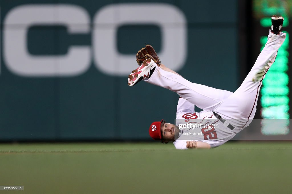 Daniel Murphy #20 of the Washington Nationals cannot make a play to second base against the Milwaukee Brewers during the fourth inning at Nationals Park on July 25, 2017 in Washington, DC.