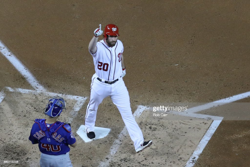Daniel Murphy #20 of the Washington Nationals celebrates after hitting a solo home run against the Chicago Cubs during the second inning in game five of the National League Division Series at Nationals Park on October 12, 2017 in Washington, DC.
