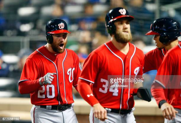 Daniel Murphy of the Washington Nationals celebrates his firstinning grand slam home run against the New York Mets as he runs back to the dugout with...