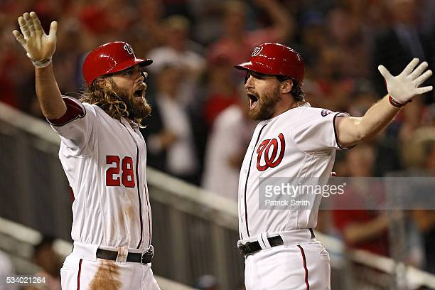 Daniel Murphy of the Washington Nationals celebrates his two run home run with teammate Jayson Werth against the New York Mets during the fifth...