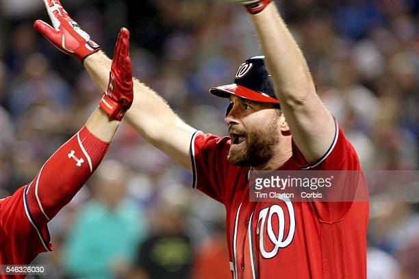 July 09: Daniel Murphy of the Washington Nationals celebrates his two run home run in the seventh inning with Bryce Harper of the Washington...