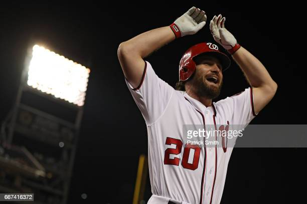 Daniel Murphy of the Washington Nationals celebrates his two run home run against the St Louis Cardinals during the fifth inning at Nationals Park on...