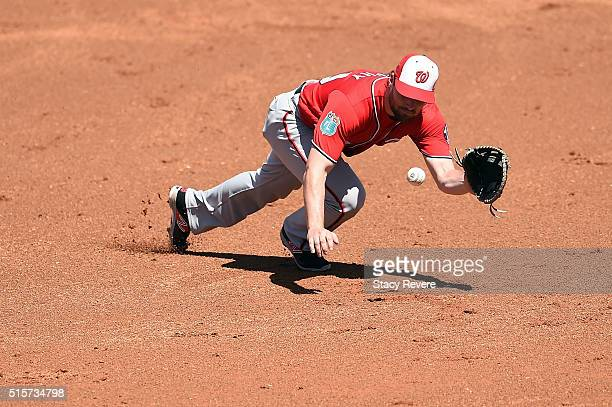 Daniel Murphy of the Washington Nationals dives for a ground ball during the second inning of a spring training game against the Houston Astros at...