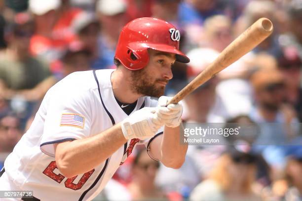 Daniel Murphy of the Washington Nationals doubles in two runs in the sixth inning during a baseball game against the New York Mets at Nationals Park...