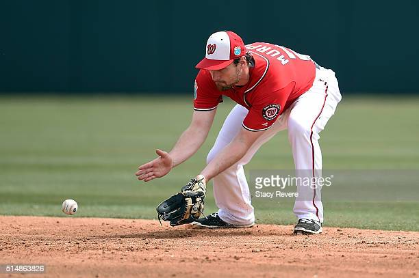 Daniel Murphy of the Washington Nationals fields a ground ball during the second inning of a spring training game against the New York Mets at Space...