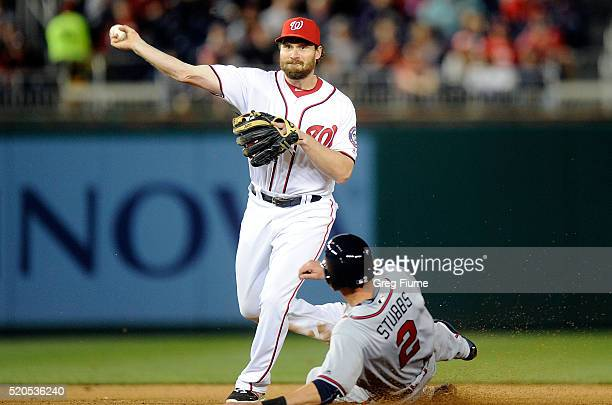 Daniel Murphy of the Washington Nationals forces out Drew Stubbs of the Atlanta Braves to start a double play in the seventh inning at Nationals Park...