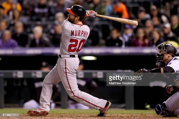 Daniel Murphy of the Washington Nationals hits a 3 RBI home run in the seventh inning against the Colorado Rockies at Coors Field on April 26 2017 in...