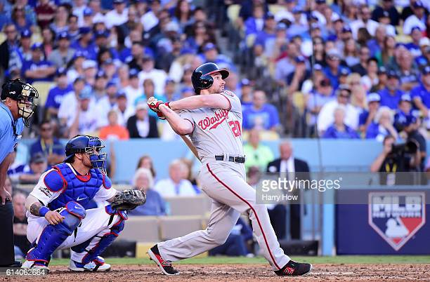 Daniel Murphy of the Washington Nationals hits a two RBI single in the seventh inning against the Los Angeles Dodgers during game four of the...