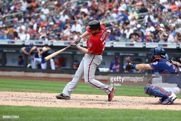 Daniel Murphy of the Washington Nationals hits a two run single in the seventh inning against the New York Mets during their game at Citi Field on...