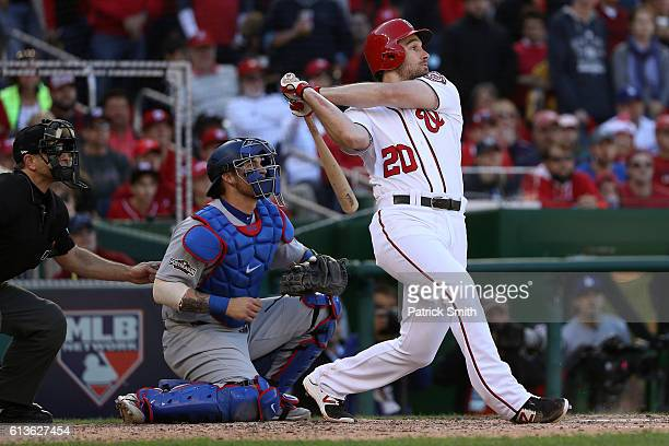 Daniel Murphy of the Washington Nationals hits an RBI single against the Los Angeles Dodgers in the fifth inning during game two of the National...