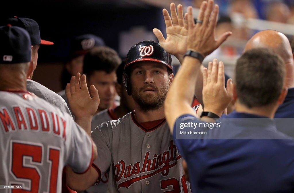 Daniel Murphy #20 of the Washington Nationals is congratulated after scoring a run in the second inning during a game against the Miami Marlins at Marlins Park on August 1, 2017 in Miami, Florida.