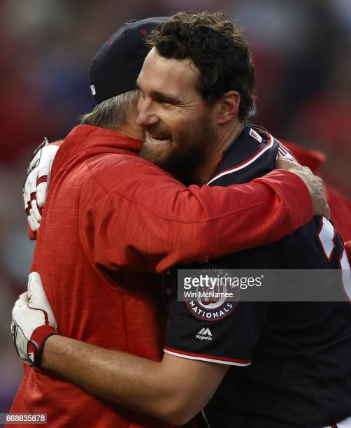 Daniel Murphy of the Washington Nationals is congratulated by one of his coaches after Murphy hit a game winning double in the tenth inning against...