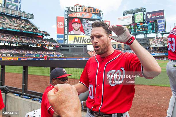 Daniel Murphy of the Washington Nationals is congratulated by team mates on his return to the dugout after hitting a two run home run in the first...