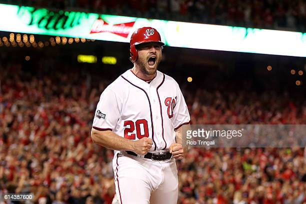 Daniel Murphy of the Washington Nationals reacts after scoring in the bottom of the second inning during Game 5 of NLDS against the Los Angeles...