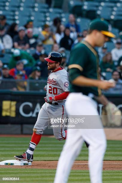Daniel Murphy of the Washington Nationals rounds the bases after hitting a home run off of Andrew Triggs of the Oakland Athletics during the third...