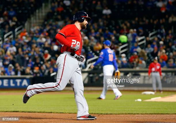 Daniel Murphy of the Washington Nationals rounds the bases after his firstinning grand slam home run against the New York Mets at Citi Field on April...