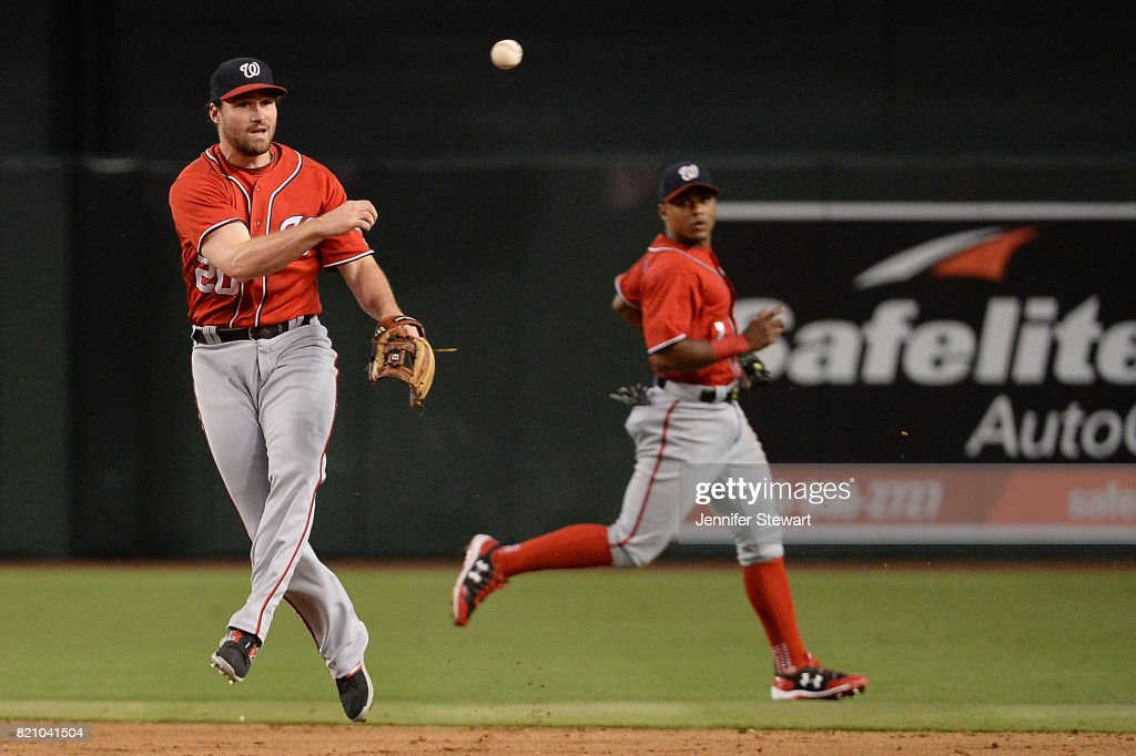 Daniel Murphy #20 of the Washington Nationals throws the ball to make the out at first against the Arizona Diamondbacks at Chase Field on July 22, 2017 in Phoenix, Arizona.
