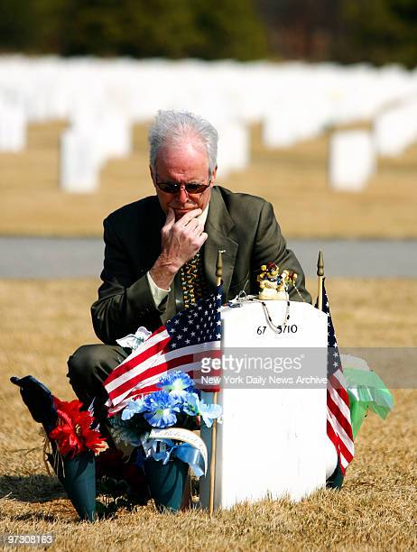 Daniel Murphy visits the gravesite of his son Navy SEAL Lt Michael Murphy at the Calverton National Cemetery in Long Island on Tuesday Lt Murphy was...