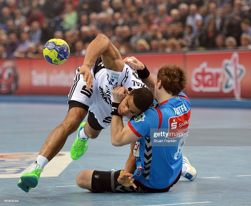 Daniel Nacisse of Kiel challenges for the ball with Jannis Fauteck of Hannover during the HBL Bundesliga game between THW Kiel and TSV Hannover-Burgdorf at the Sparkassen arena on February 13, 2013 in Kiel, Germany.