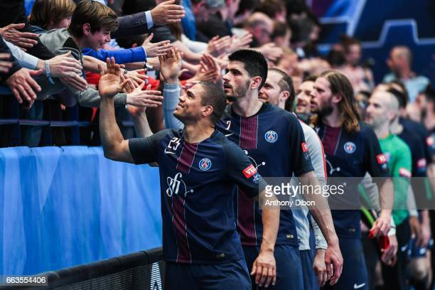 Daniel Narcisse and team of PSG celebrates the victory with fans during the Champions League match between Paris Saint Germain and Nantes at Stade...