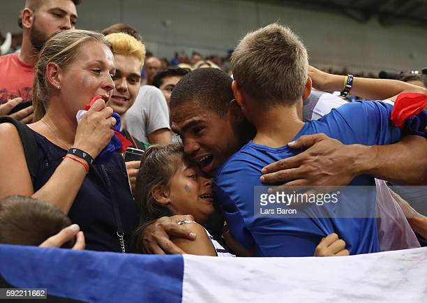 Daniel Narcisse of France celebrates their victory with his children after the Men's Handball Semifinal match between France and Germany on Day 14 of...