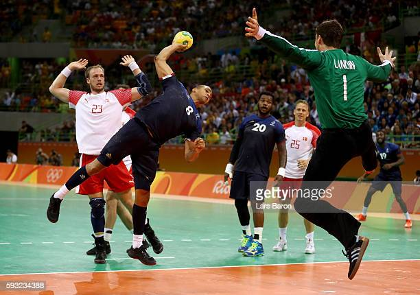 Daniel Narcisse of France jumps to shoot against Niklas Landin Jacobsen of Denmark during the Men's Gold Medal Match between Denmark and France on...