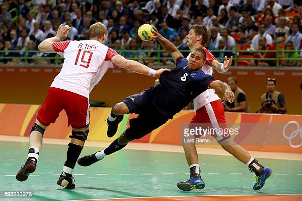 Daniel Narcisse of France jumps to take a shot during the Men's Gold Medal Match between Denmark and France on Day 16 of the Rio 2016 Olympic Games...