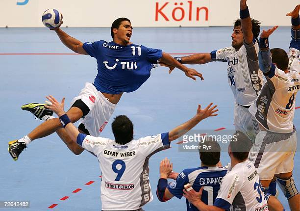 Daniel Narcisse of Gummersbach shoots on goal as players of Lemgo try to block him during the Club European Championship match between VFL...