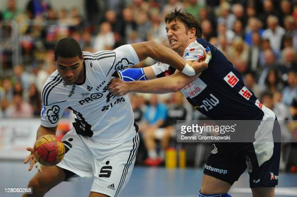 Daniel Narcisse of Kiel and Jens Buerkle of Balingen battle for the ball during the Toyota Handball Bundesliga match between HBW BalingenWeilstetten...