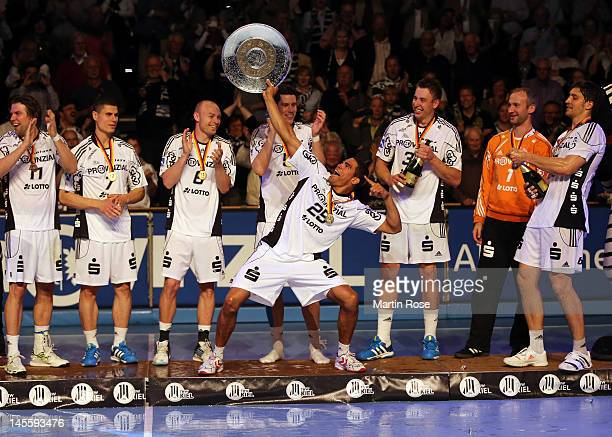 Daniel Narcisse of Kiel celebrate lifts the trophy after winning the german handball championship after the Toyota Handball Bundesliga match between...