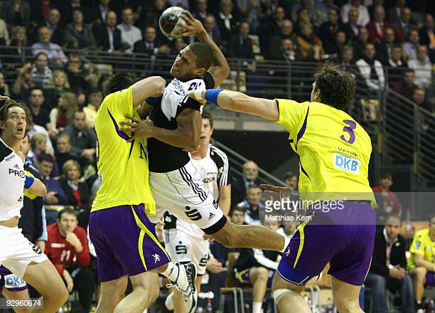 Daniel Narcisse of Kiel is attacked by Michal Kubisztal of Berlin and Stian Fredrik Vatne during the Toyota Handball Bundesliga match between Fuechse...