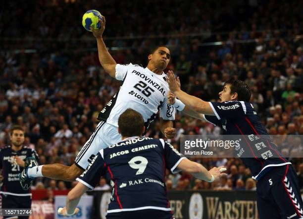 Daniel Narcisse of Kiel is challenged by Arnor Atlason of Flensburg during the DKB Handball Bundesliga match between THW Kiel and SG...