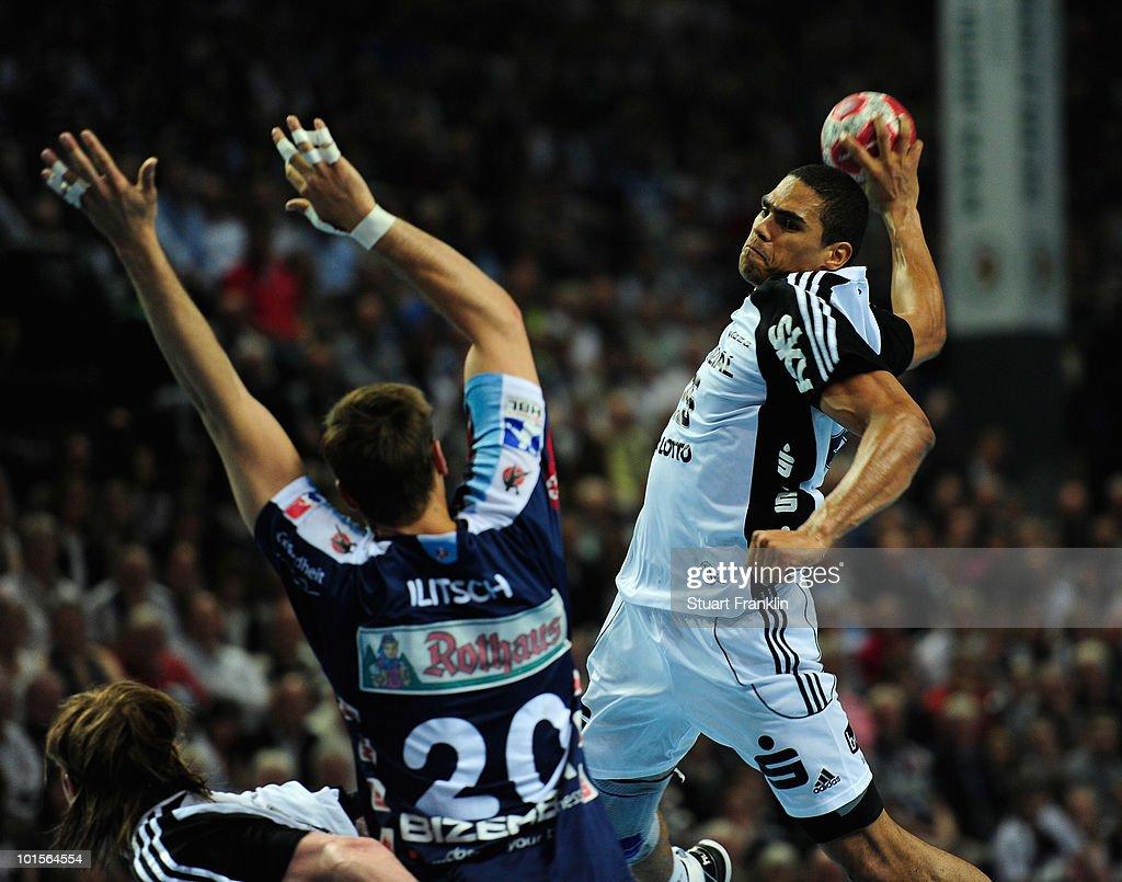 Daniel Narcisse of Kiel is challenged by Sascha Iltsch of Balingen during the Toyota Handball bundesliga match between THW Kiel and HBW Balingen-Weilstetten at the Sparkassen Arena on June 2, 2010 in Kiel, Germany.