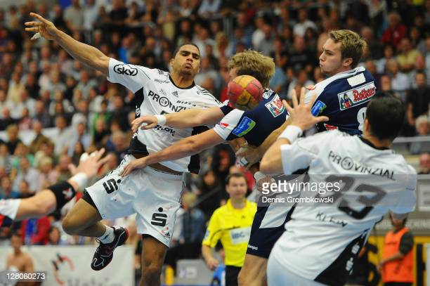 Daniel Narcisse of Kiel passes the ball to team mate Dominik Klein during the Toyota Handball Bundesliga match between HBW BalingenWeilstetten and...
