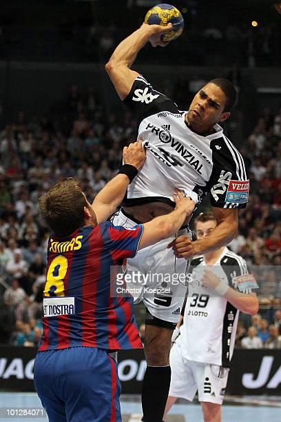 Daniel Narcisse of Kiel scores a goal against Victor Tomas González of Barcelona Borges during the handball final match between THW Kiel and FC...