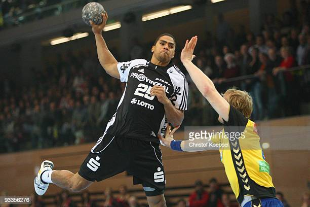Daniel Narcisse of Kiel throws the ball and Michael Hegemann of Duesseldorf blocks him during the Toyota Handball Bundesliga match between HSG...