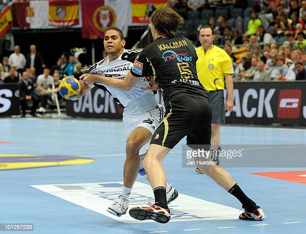 Daniel Narcisse of THW Kiel and Jonas Kallman of Ciudad Real battle for the ball during handball semi final match between Ciudad Real and THW Kiel on...