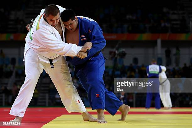Daniel Natea of Romania competes against Kunathip YeaOn of Thailand during the Men's 100kg Judo contest on Day 7 of the Rio 2016 Olympic Games at...