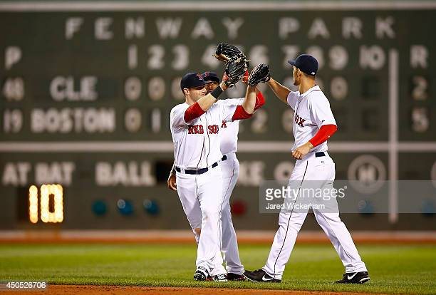 Daniel Nava Jackie Bradley Jr and Grady Sizemore of the Boston Red Sox celebrate their 52 win against the Cleveland Indians during the game at Fenway...