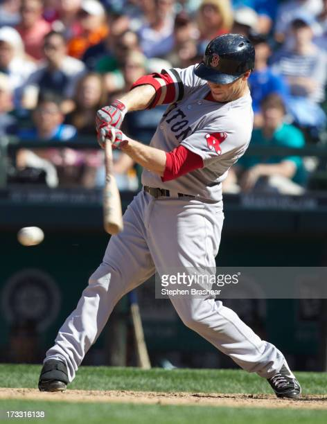 Daniel Nava of the Boston Red Sox hits a gamewinning RBI single in the tenth inning of a game against the Seattle Mariners at Safeco Field on July 11...