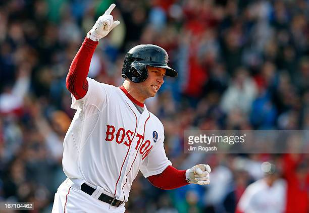 Daniel Nava of the Boston Red Sox reacts after hitting a threerun home run against the Kansas City Royals in the 8th inning at Fenway Park on April...