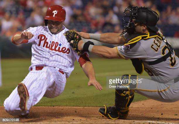 Daniel Nava of the Philadelphia Phillies gets tagged out at home plate by Francisco Cervelli of the Pittsburgh Pirates in the seventh inning at...