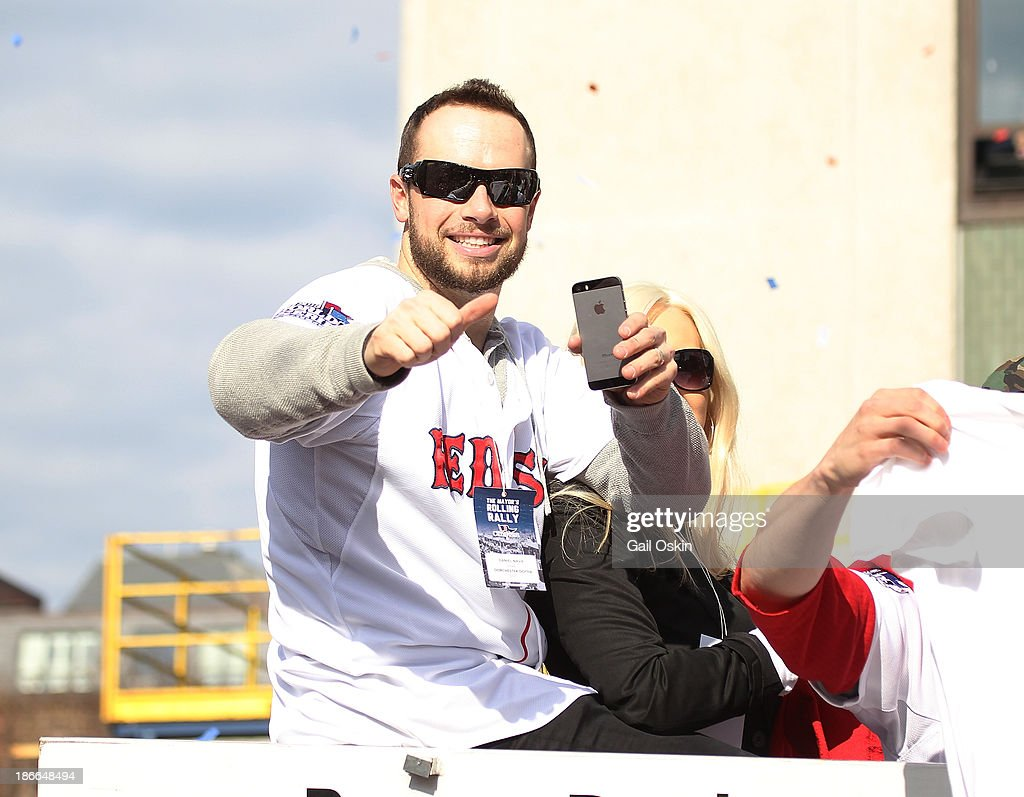 Daniel Nava waves from one of the duck boats as they make their way down Boylston Street where fans gathered for the World Series victory parade for the Boston Red Sox on November 2, 2013 in Boston, Massachusetts.