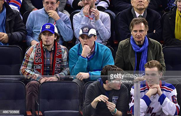 Daniel Neeson guest and Liam Neeson attend Chicago Blackhawks vs New York Rangers game at Madison Square Garden on March 18 2015 in New York City