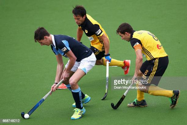 Daniel Nelson of Lisnagarvey battles for the ball with Albert Beltran and Marc Salles of Atletic Terrassa HC during the Euro Hockey League KO16 match...