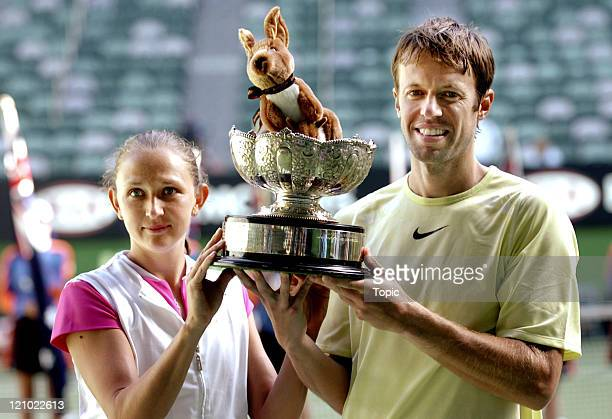 Daniel Nestor and Elena Likhovtseva hold the Mixed Doubles winners trophy at the 2007 Australian Open at Rod Laver Arena Melbourne Australia January...