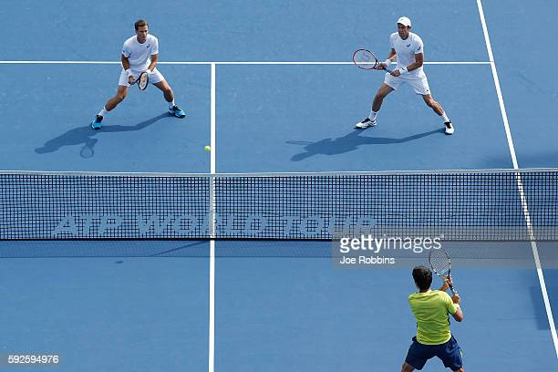 Daniel Nestor and Vasek Pospisil of Canada play against Ivan Dodig of Croatia and Marcelo Melo of Brazil during their semifinal doubles match on Day...
