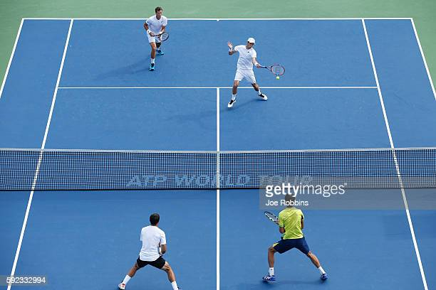 Daniel Nestor and Vasek Pospisil of Canada return against Ivan Dodig of Croatia and Marcelo Melo of Brazil during their semifinal doubles match on...