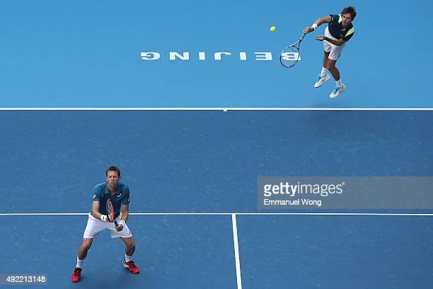 Daniel Nestor of Canada and Edouard RogerVasselin of France serve against Jack Sock of the United States and Vasek Pospisil of Canada during the...